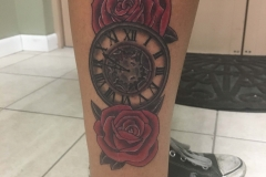 rose and clock tattoo by Ei Omiya at Funhouse Tattoo San Diego