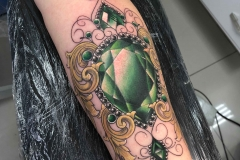 green jewel tattoo by Karlla Mendes