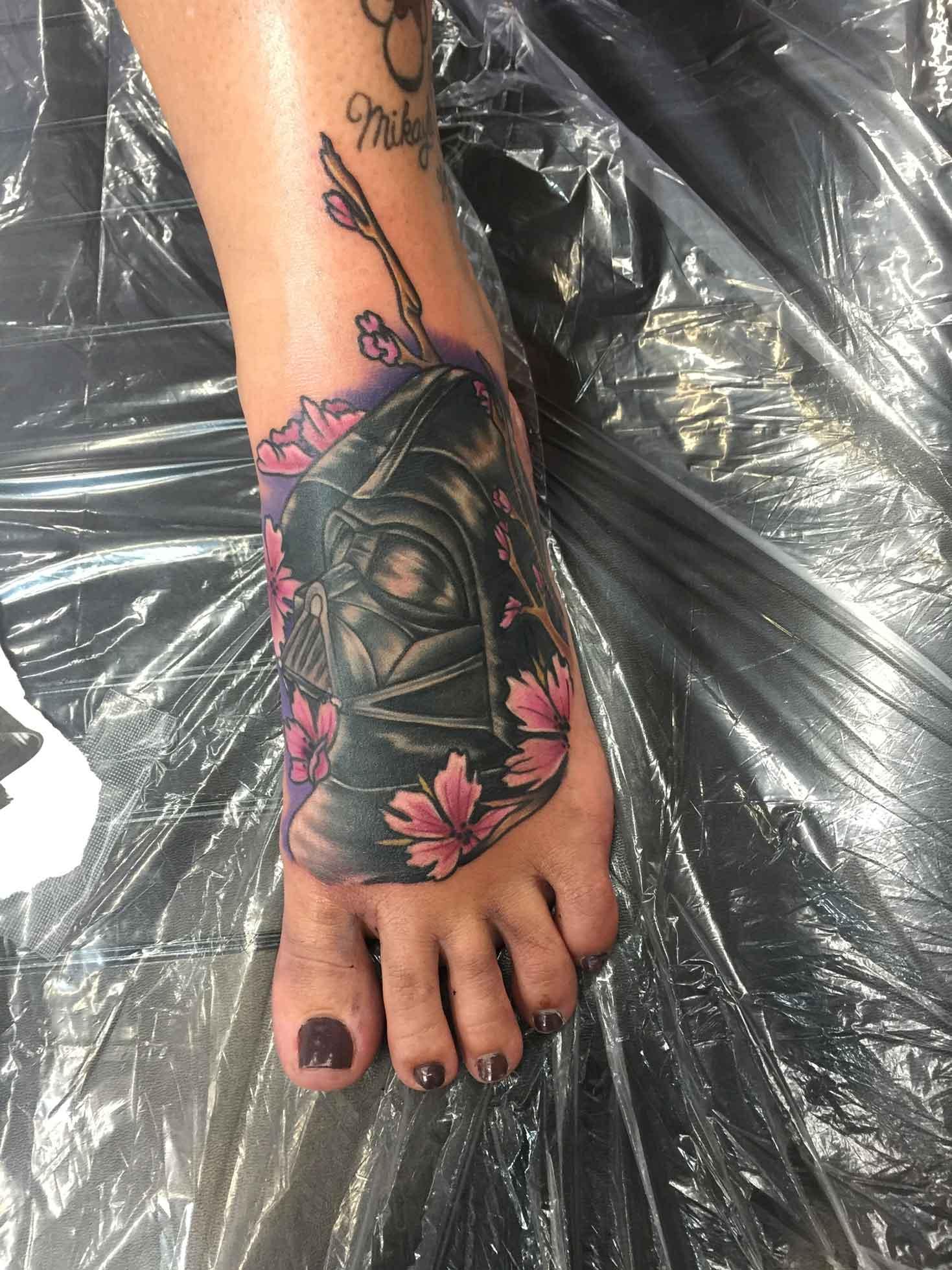 llustrative-tattoo-of-darth-Vader-helmet-on-foot