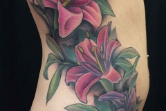 large-color-tattoo-of-illustrative-realism-lillies