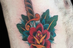 traditional-style-tattoo-of-dagger-and-rose-by-Roger-Solis-in-San-Diego