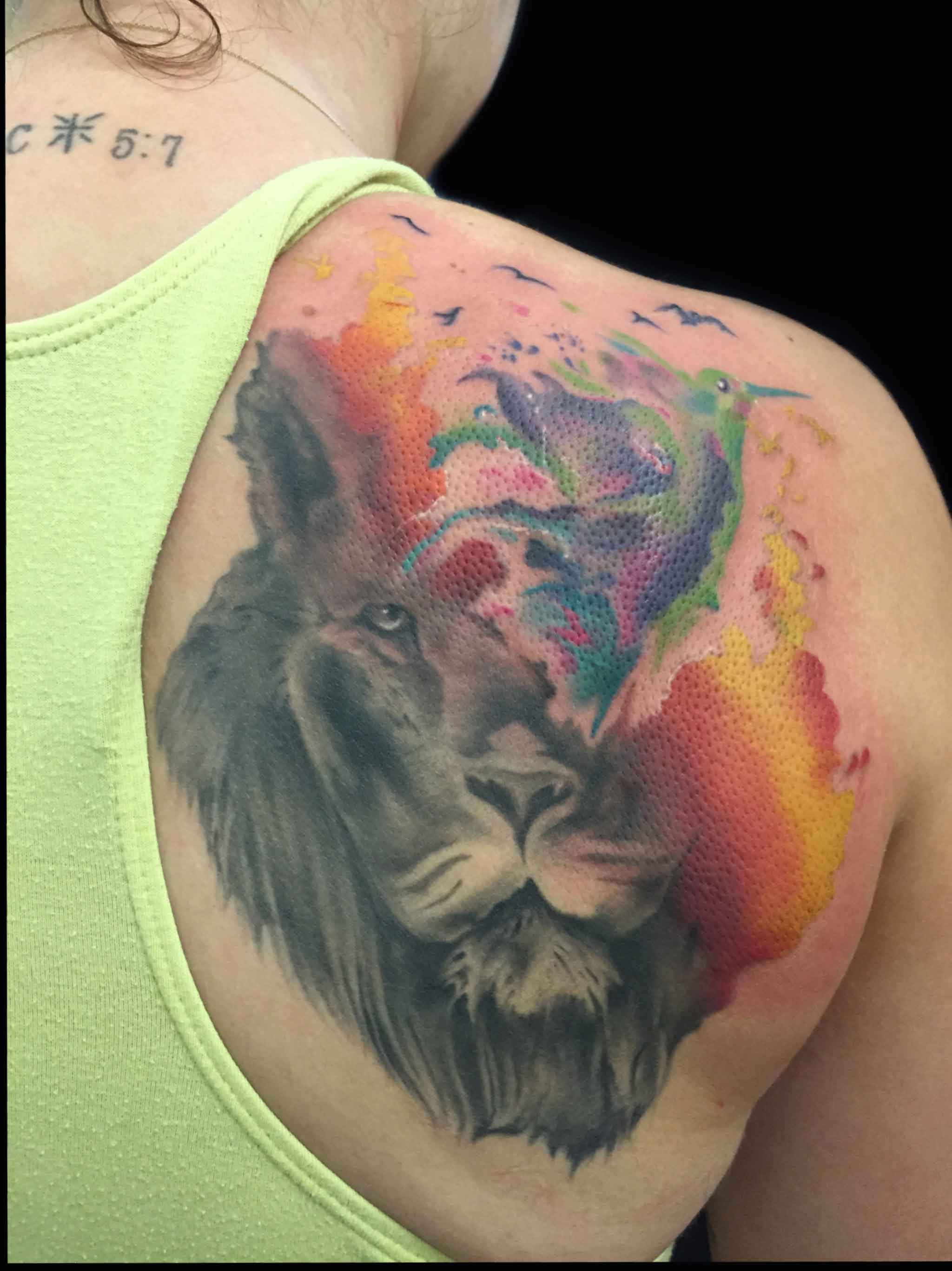 watercolor srtyle tattoo of lion by Roger Solis